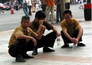 squatting-men-beijing-wangfujing